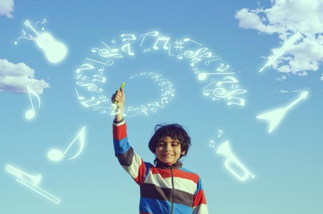 魔法の言葉を唱える少年
